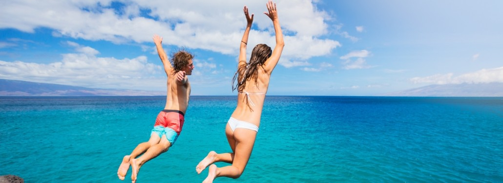 Summertime Couple Jumping into Water
