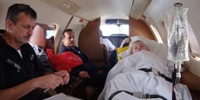 Medical evacuation team and young patient in-flight