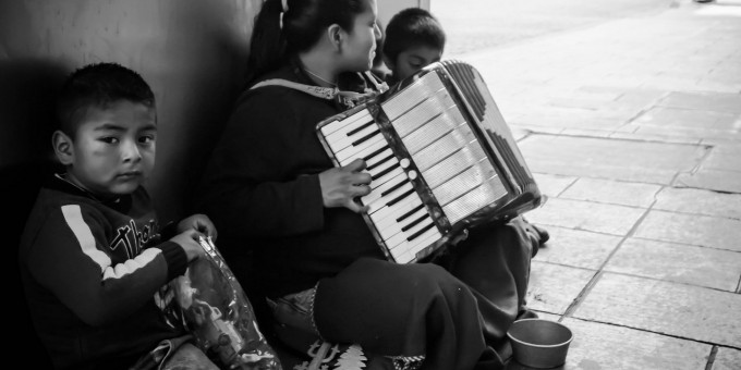 Family playing accordion for tips in Mexico City. Mundial Photo