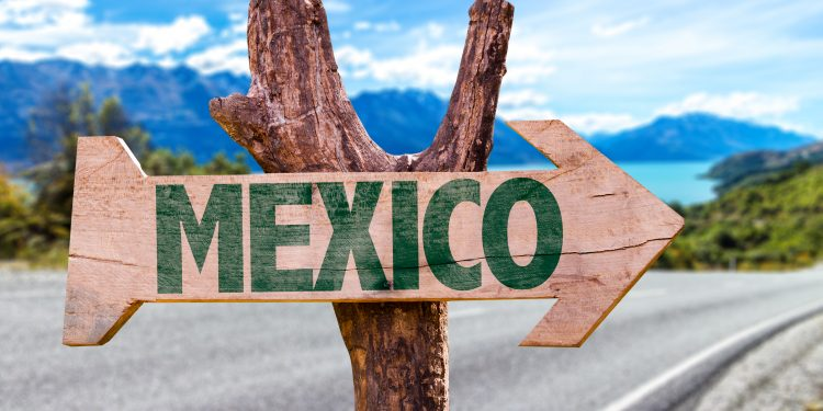 Sign Pointing to Mexico