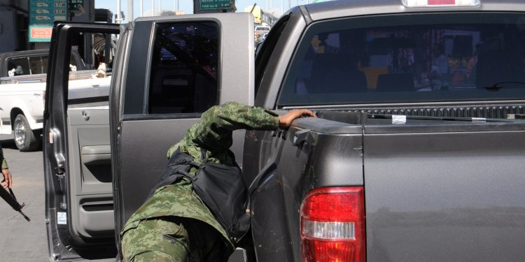 Soldier Checks Vehicle in Mexico