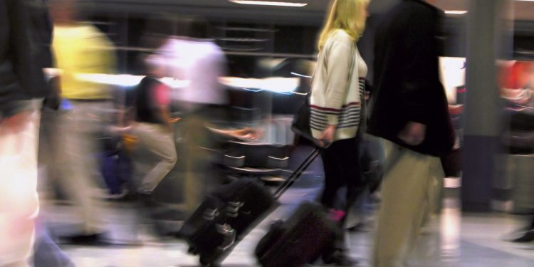People traveling with baggage
