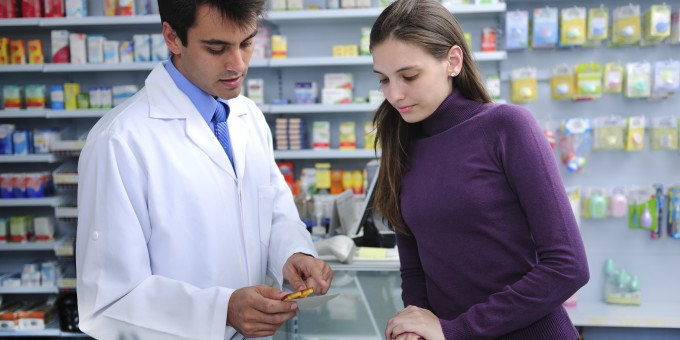 Pharmacists advising patient