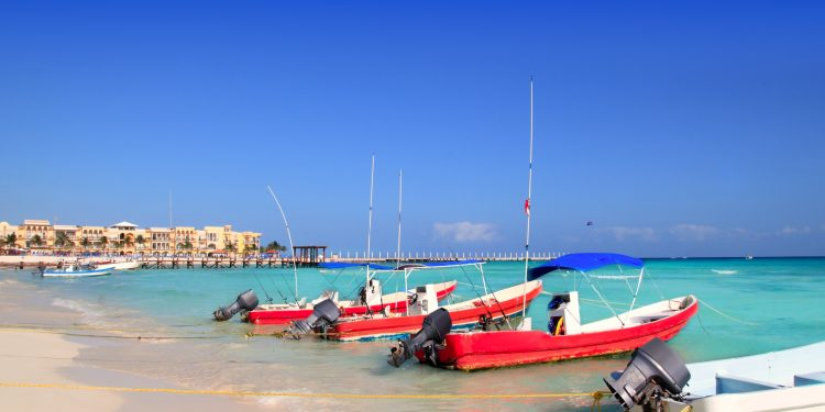 Boats on the shore at Playa del Carmen in Mexico