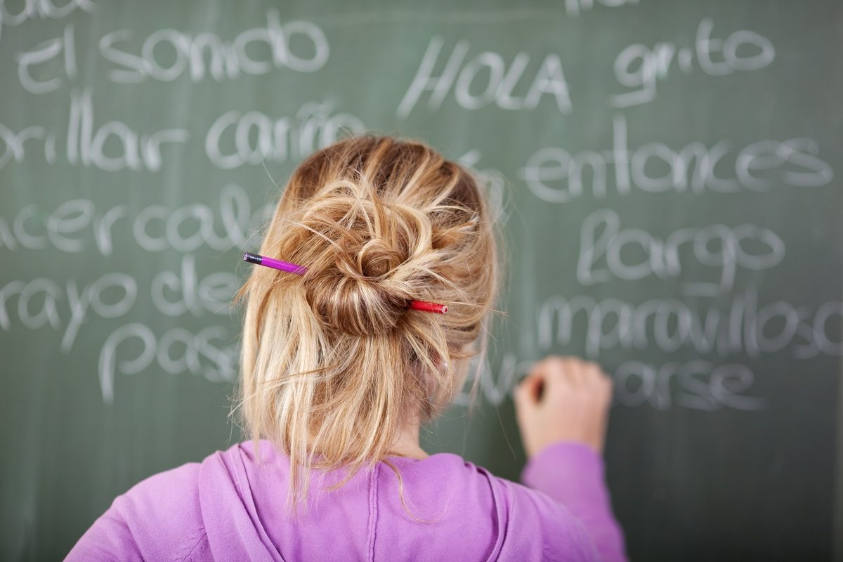 Writing Spanish on a chalkboard