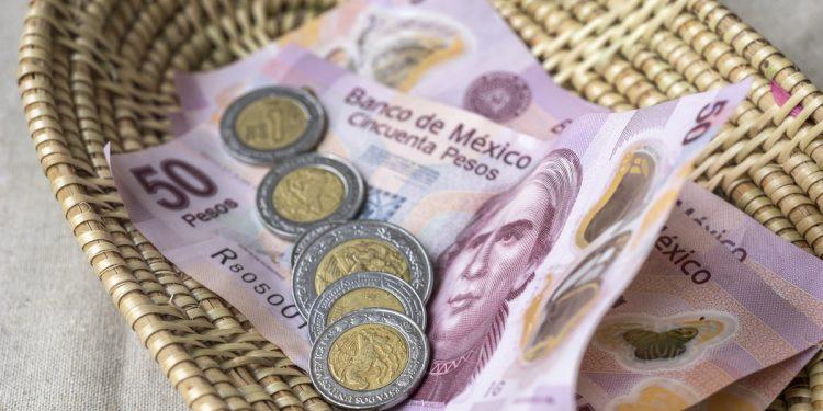 Tip money in a basket