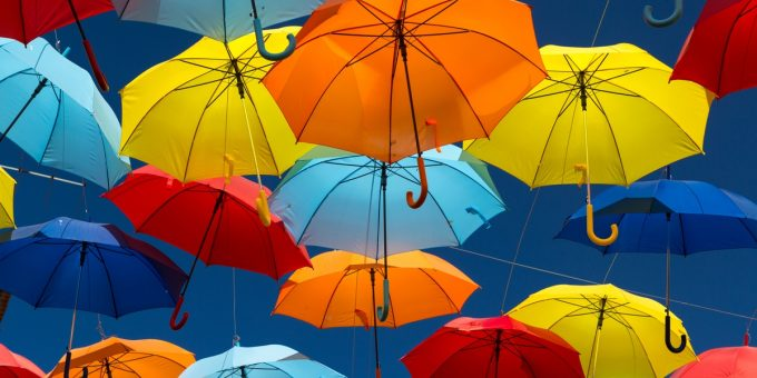 Umbrellas Covering Sky